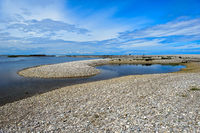 Inshore banks of shingle at the mouth of the River Spey, Spey Bay, Scotland, Great Britain