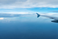 plane wing view in the sky