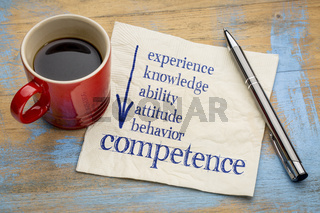 competence concept on napkin with coffee
