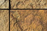 Facade of natural stone panels