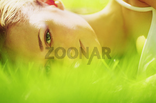 woman lay on grass