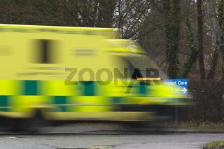 an ambulance car speeding towards urgent care