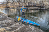 Stand up paddling on the Poudre RIver in Colorado