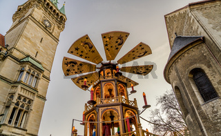 Huge Christmas pyramide at the Christmas market in Braunschweig with the town hall and the cathedral