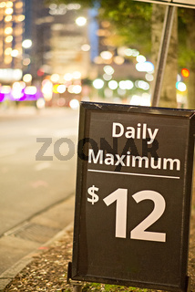 daily and hourly parking sign in the city