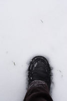 male foot stepping into fresh snow
