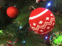 Christmas tree ornaments hanging on a tree
