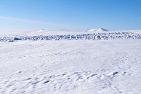 Altai plain winter landscape with snow field under blue sky