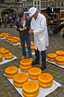 farmer, left, and a cheese merchant, bargain over the price of Gouda cheese,cheese market Gouda
