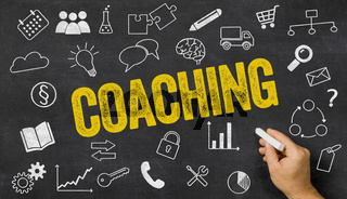 Coaching written on a blackboard with icons