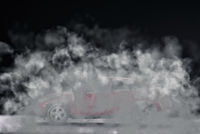 Car disappears in the smoke of its exhaust
