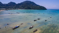 Aerial drone photo of boats on the sea during ebb tide on iconic tropical beach  of Phi Phi island