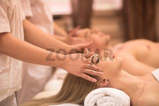couple enjoying head massage at the spa