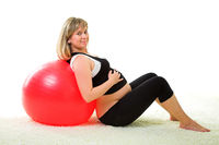 Pregnant woman with gymnastic ball