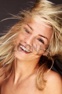 Gorgeous Blond Woman Fluttering Her Golden Hair
