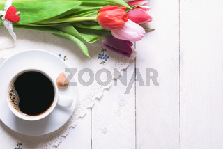 Coffee and bouquet of tulips