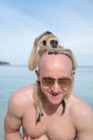Man with monkey on the beach