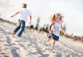 Adorable Brother and Sister Having Fun at the Beach