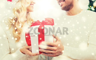 close up of couple with christmas gift at home