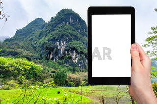 tourist photographs karst mountain in Yangshuo