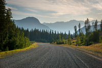 Gravel road in Kananaskis Country with haze from forest fires in