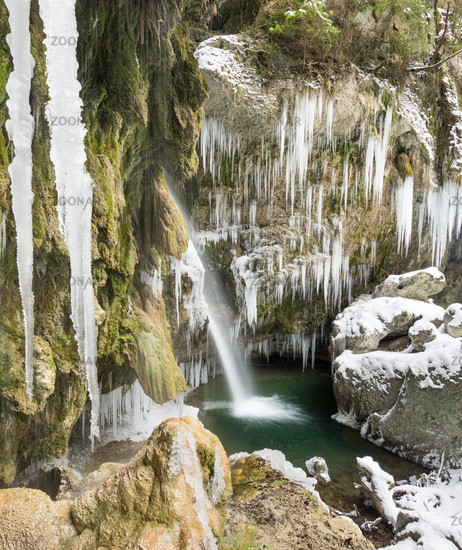 Amazing icicles and waterfall gorge on cold winter day. Hinanger Waterfall, Bavaria, Germany