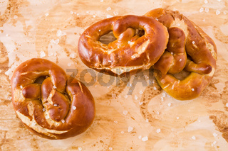 Several salty cooked pretzel seen from above