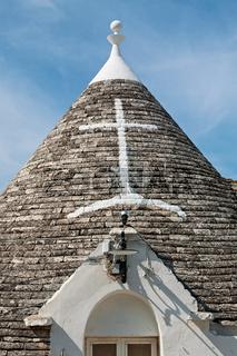 Symbol in the Trullo conical rooftop in Alberobello, Apulia, Italy