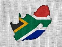 Karte und Fahne von Südafrika auf altem Leinen - Map and flag of South Africa on old linen