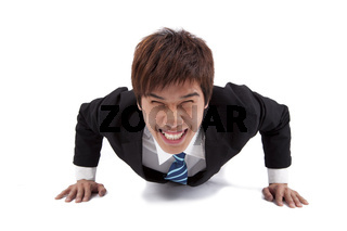 Young happy businessman make push-ups  and fitness