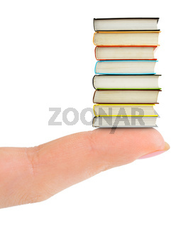 Finger and books