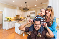 Young Mixed Race Family Having Fun in Custom Kitchen