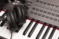 Listening Headphones Laying on Electronic Synthesizer Keyboard