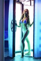 Beautiful tall brunette posing in solarium