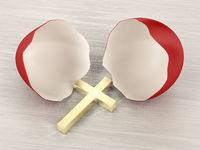 Broken eggshell and cross