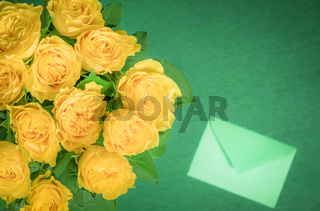 Yellow roses bouquet and a letter