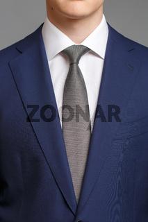 man in blue tuxedo with grey tie