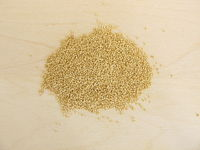 Amaranth seeds on wooden board