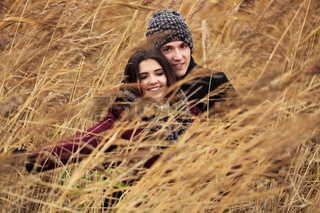 Happy young fashion couple walking outdoor