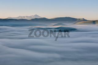 Above the fog, Castelluccio, Italy