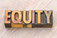 equity word abstract in wood type