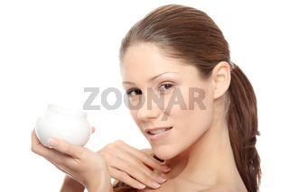 Beautiful young woman with cream