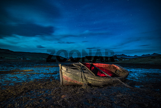 Lonely boat at night