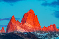The cliffs Fitz Roy in crimson light of sunset