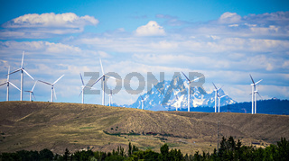 wind turbine farm with wenatchee mountains in the background