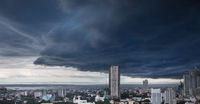 Heavy storm clouds over modern city