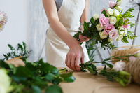 Image of woman making bouquet
