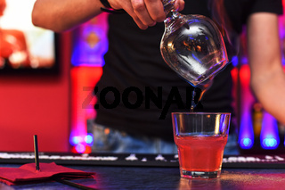 Barmen making cocktail