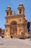 The view of the parish church in the Marsaxlokk fishing village, Malta