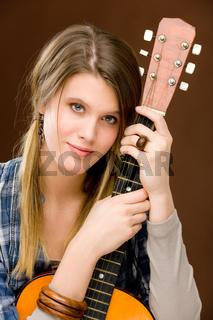 Rock musician - fashion woman holding guitar